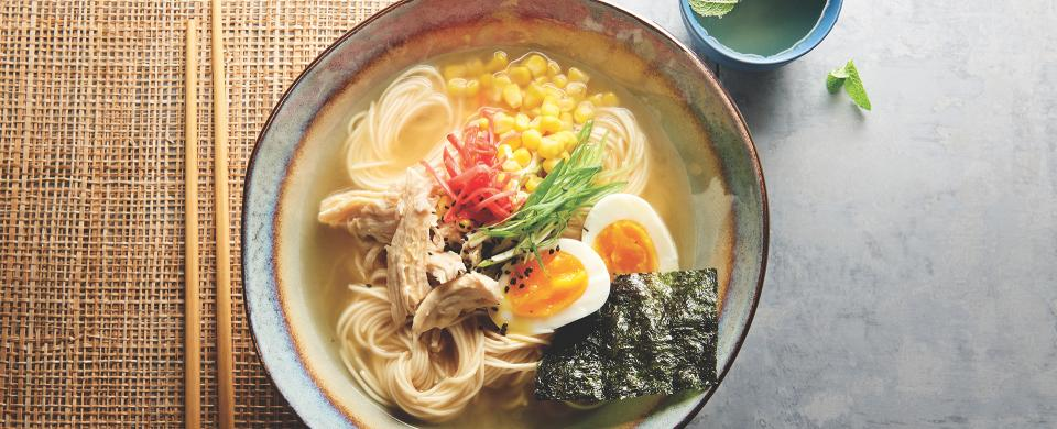 A bowl of Chicken Ramen with egg and nori sheet